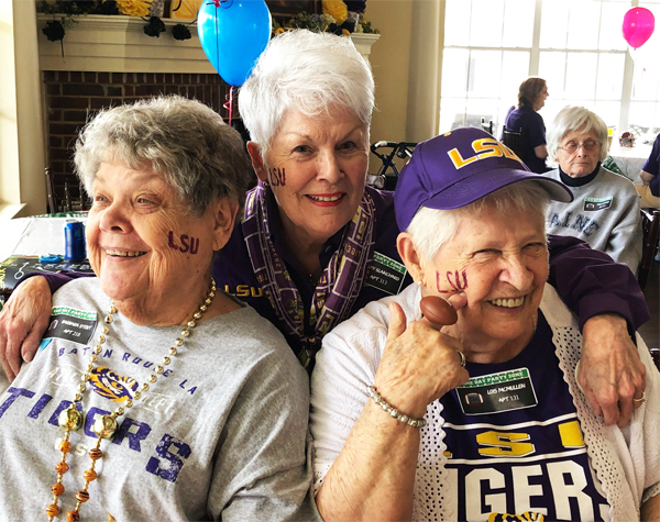 3 ladies wearing LSU shirts