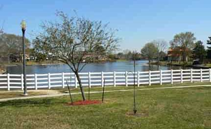 view of lake with fence
